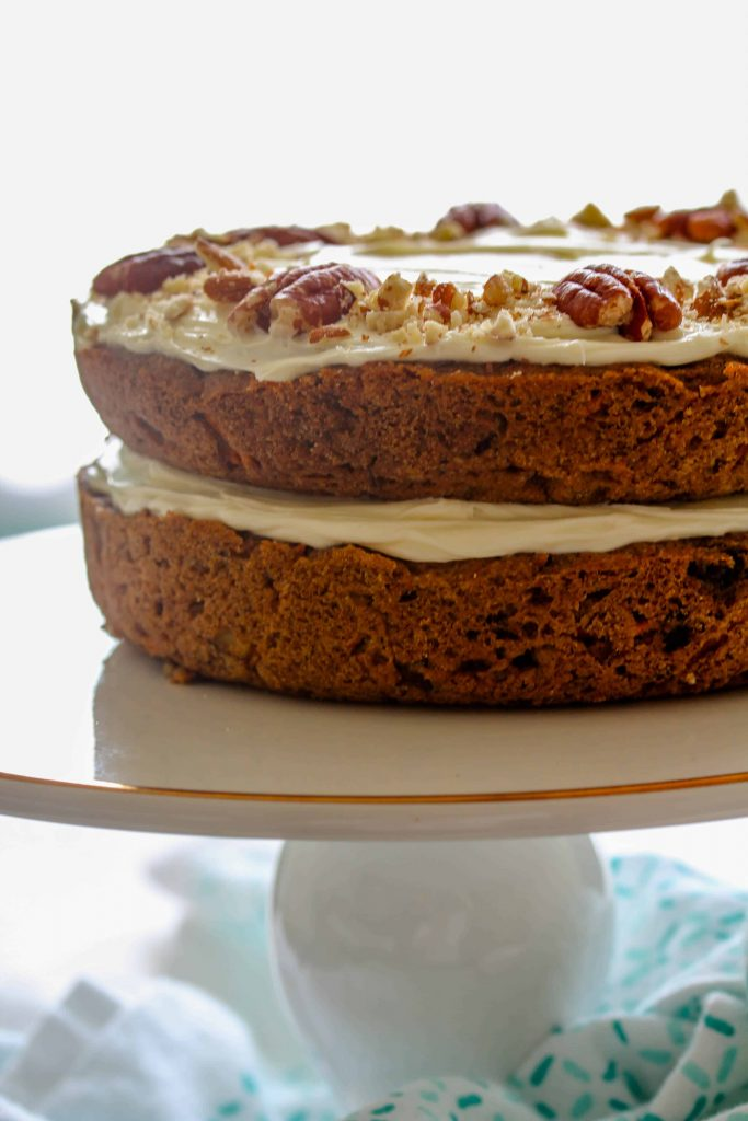 Moist, dense, and flavorful, this Healthy Vegan Carrot Cake actually is the healthy dessert you always thought you were eating. Topped with a creamy, high protein frosting, your taste buds will thank you after having this yummy cake!