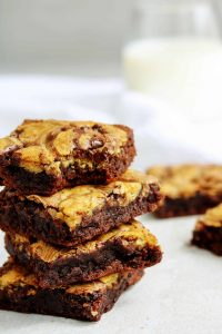 "If you can't decide between having a brownie or a chocolate chip cookie just combine them into one! This healthy, high protein ""brookies"" recipe is low carb, vegan, gluten free, and insanely delicious! They even make a great post workout snack - you're going to want to bake these ASAP!"