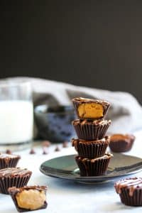 These easy no bake high protein peanut butter cups are like little bites of fudge covered in chocolate. These homemade treats are like a Reeses cup only better! You only need a few ingredients to make this healthy snack. It's packed with plant based protein, vegan, and gluten free. Take them on the go or have them as a post workout snack!