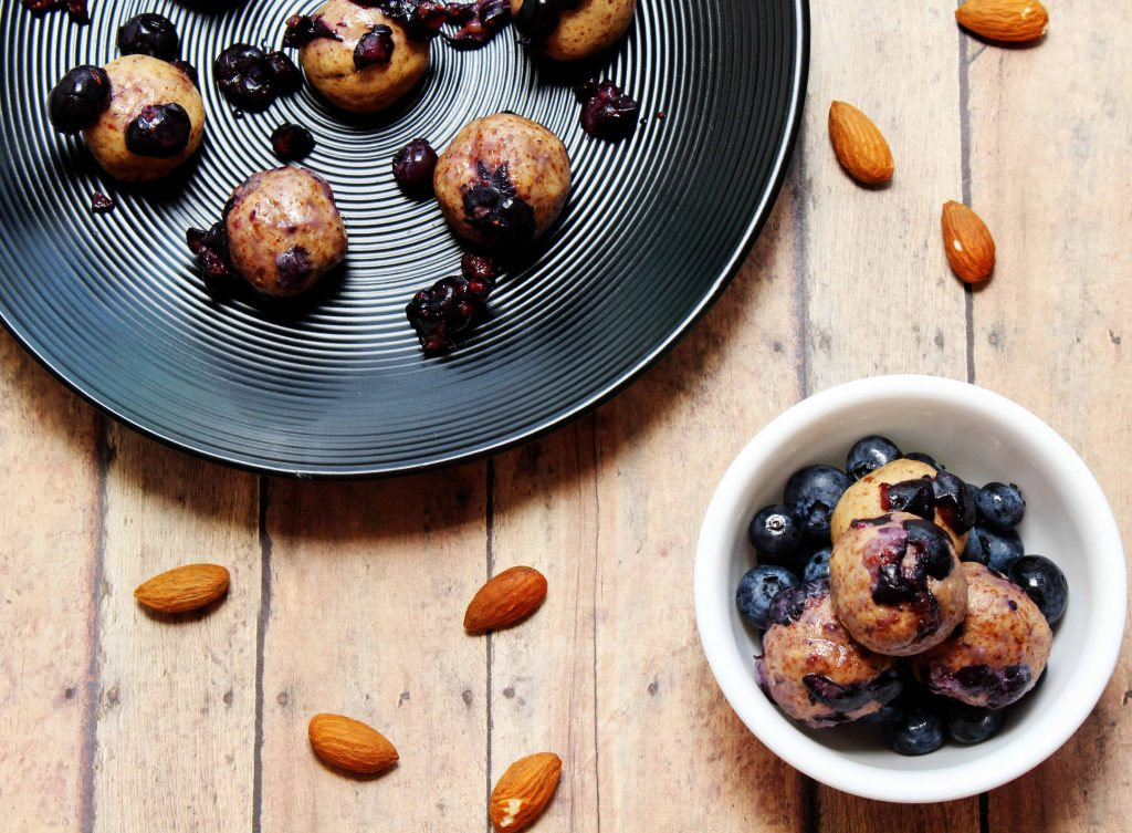 These no bake, high protein Blueberry Cookie Dough Energy Bites are the perfect quick, on-the-go snack! They only take 15 minutes to make and are great for a post workout snack! #highprotein #postworkout #healthysnacks