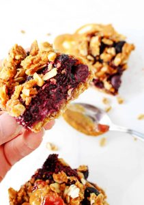 If the classic sandwich had a fancy older sister, these No Bake Peanut Butter and Jelly Bars would be it! They look pretty, but are really easy to make! They're creamy, chewy, made in one bowl, and are refined sugar free, vegan, and gluten free!