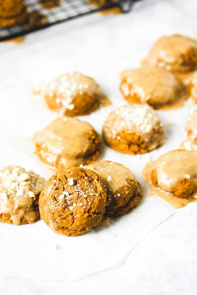 I've never loved an idea more than this healthy dessert recipe for high protein pumpkin spice cookies! They're light and fluffy and topped with a creamy vegan cream cheese frosting. These delicious cookies are made mostly in a blender, so they're super easy to make. Grab some for the perfect afternoon snack or even after a workout! You won't believe how wholesome the ingredients are! #pumpkin #fall #dessert #healthycookies #pumpkinspice #highprotein #easysnacks #recipe #HealthyHacks