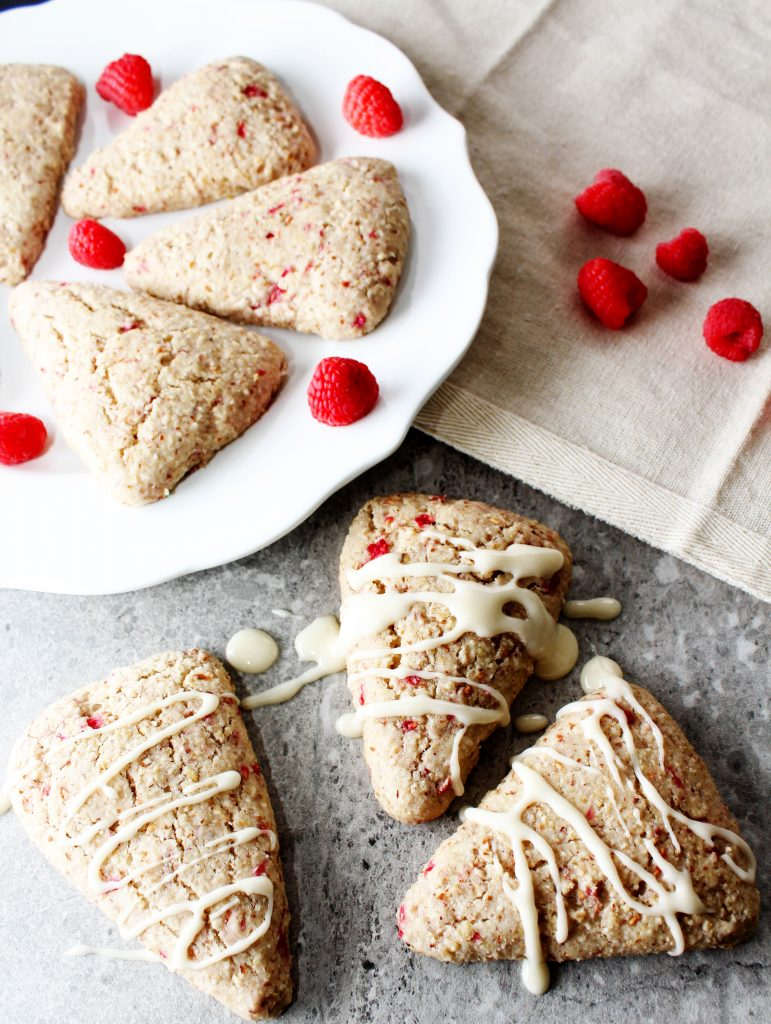 This simple and easy dessert recipe for healthy lemon raspberry scones is perfect if you're a beginner at making scones. They're full of whole grains and make the perfect dessert or on the go breakfast. They're also vegan, gluten free, and low FODMAP.