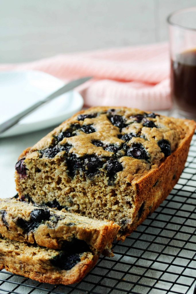 This healthy blueberry banana bread is a toast lover's dream! You can make it gluten free or with whole wheat flour. Toast it up and spread it with your fave nut butter and jelly for the perfect quick and healthy snack! #glutenfree #lowfodmap #blueberry #bananabread