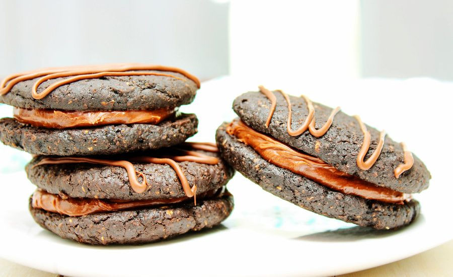 These Healthy Chocolate Fudge Round Sandwich Cookies will transport you back to your childhood! The cookies are soft and chewy and the frosting is rich and creamy. Only difference is that this dessert is healthy and high in protein! They're vegan and gluten free, too!