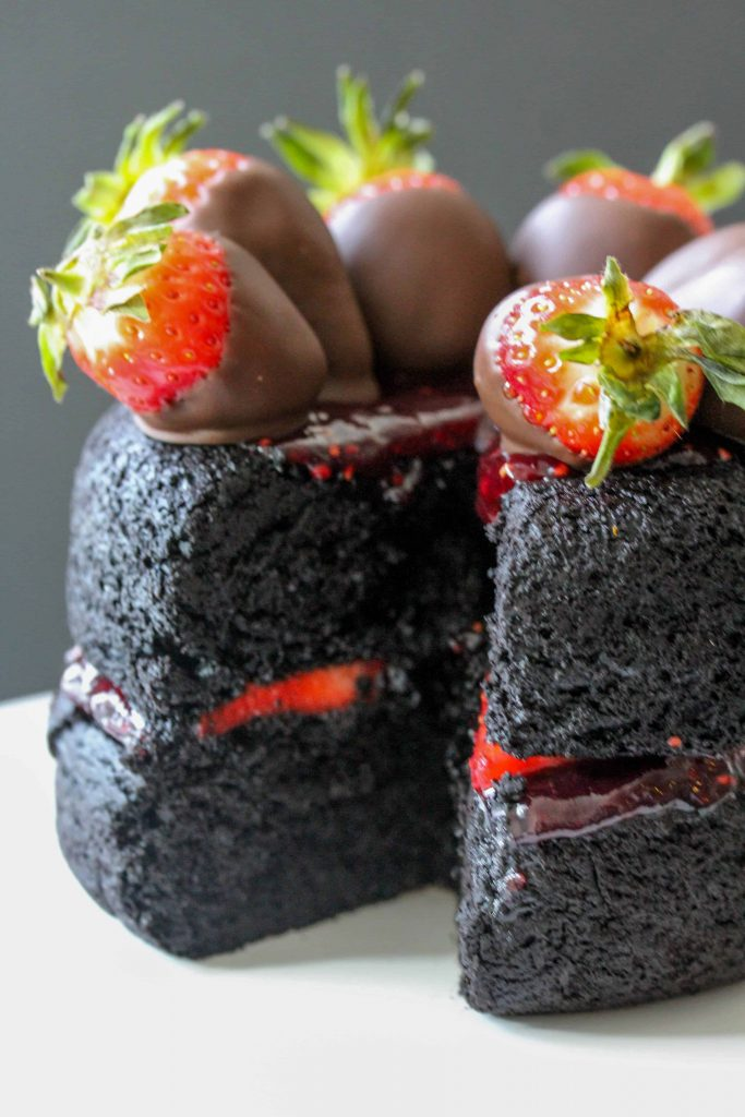 This recipe for dark chocolate strawberry cake is the perfect mix of a cake and a brownie! It's slightly fluffy, slightly fudgy, and all delicious! Perfect for a Valentine's Day dessert.