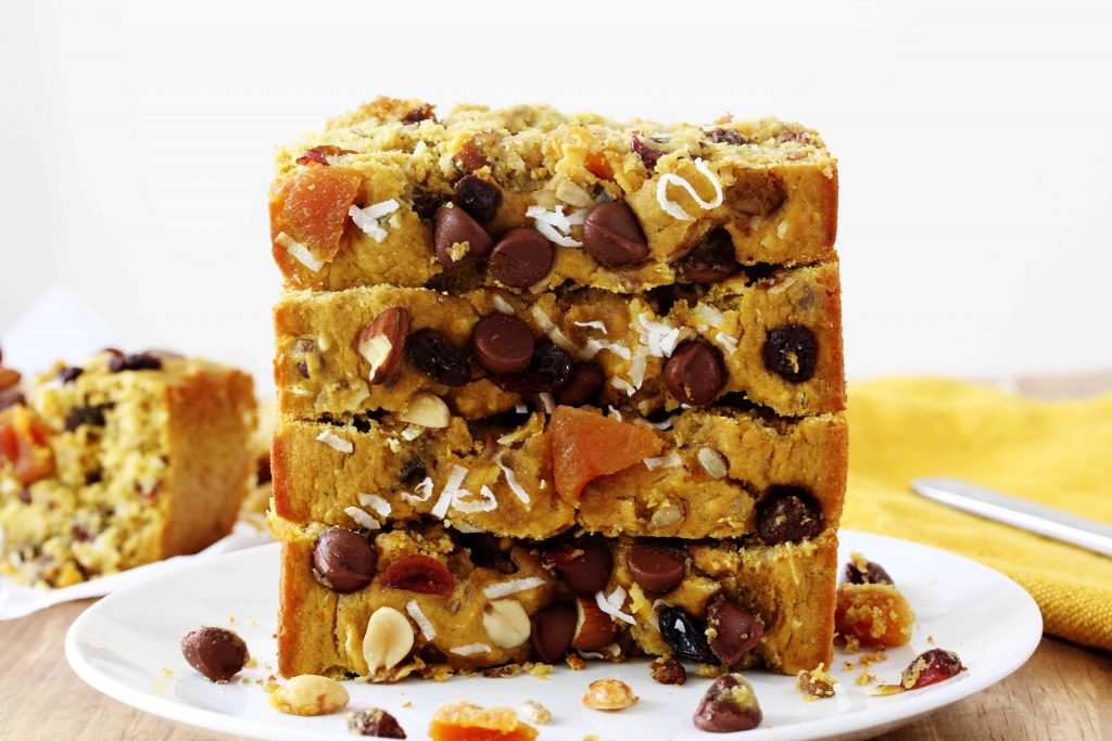 The classic on-the-go snack gets a makeover in this Healthy Trail Mix Quick Bread. Everything you love about the mixture of seeds, nuts, and chocolate all mixed in to a high protein, high fiber, easy to make loaf bread recipe. It also happens to be gluten free and vegan friendly!