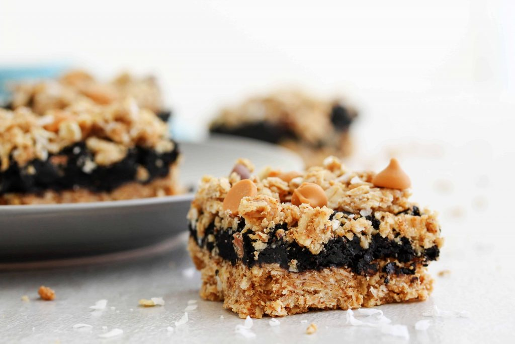 If there's anything better than chocolate layered between a sweet, crunchy, almond, coconut, crumb bar, I don't know what it is! This recipe for healthy almond chocolate layer bars is actually really easy to make and is sure to be a huge crowd pleaser (if it even makes it to the crowd ;) ). It's also refined sugar free, gluten free, vegan, and Low FODMAP. #vegandessert #glutenfreedessert #healthyrecipes