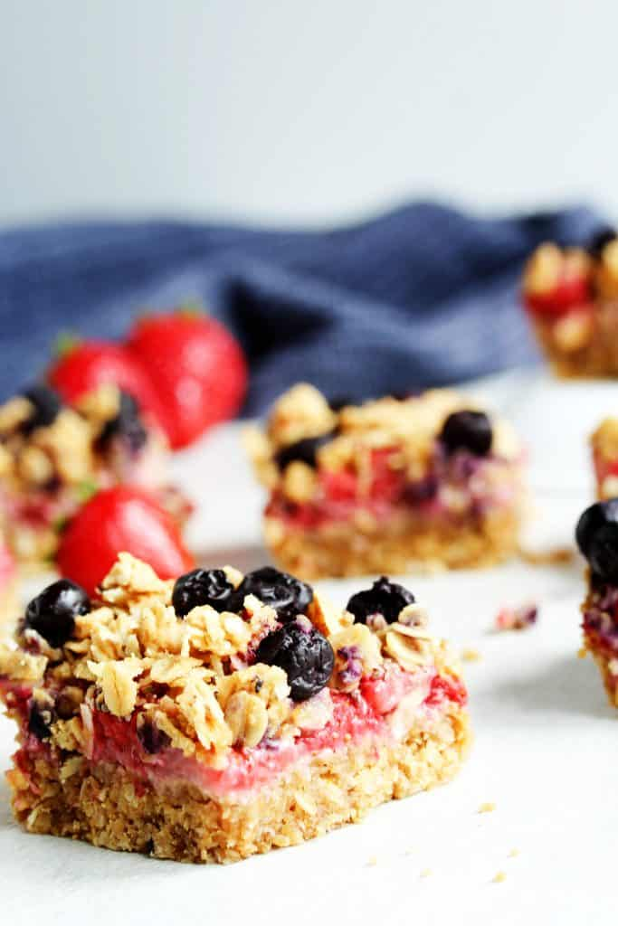 This easy dessert recipe for Red White and Blueberry Crumb Bars makes the perfect healthy Fourth of July dessert! Look no further for your summer party ideas! Oats, strawberries, and blueberries make up this chewy dessert that's also gluten free, vegan, and just a few ingredients. #healthydesserts #fourthofjuly #redwhiteandbluedesserts #partyideas #easydessert #easyrecipes #vegandesserts #glutenfreedesserts #summer