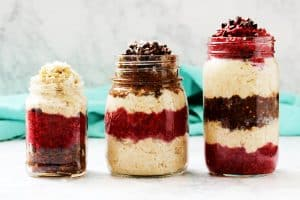 This easy recipe for healthy chocolate raspberry overnight oats in a jar is perfect for a quick grab and go breakfast or afternoon snack. They're great to add to your meal prep menu! Plus they're full of wholesome ingredients, low in added sugar, vegan, and gluten free! Check out the recipe! #mealprep #overnightoats #easyrecipe #quickbreakfast #makeahead #raspberry #chocolate #HealthyHacks