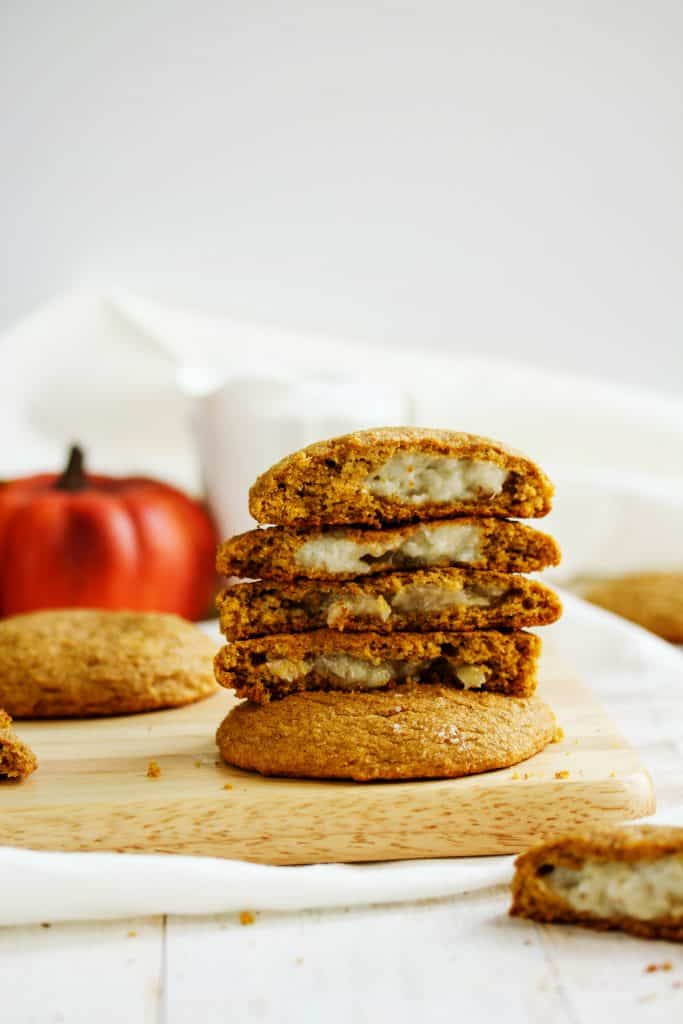 These banana pudding stuffed pumpkin cookies are the perfect healthy dessert! They're full of fall flavors, look impressive, but are actually easy to make. This recipe makes huge bakery style cookies that you won't want to put down! Bake some up for the Holidays! #pumpkin #cookies #pudding #glutenfree #vegan #HealthyHacks