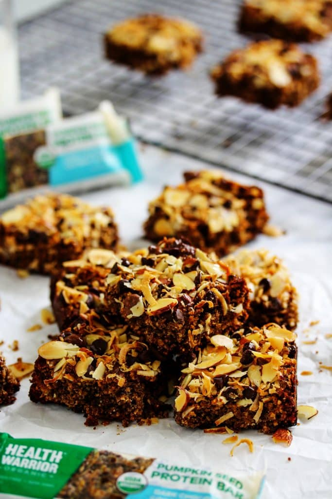 These easy, homemade High Protein Dark Chocolate Coconut Almond Brownies are the perfect healthy dessert recipe for any chewy brownie lover. They're dense, fudgey, and moist, and have little bits of nuts and seeds sprinkled throughout for a nice added crunch. The chocolate flavor is complimented with the added flavors of almond butter and coconut. They're also vegan, gluten free, and packed with healthy fats.