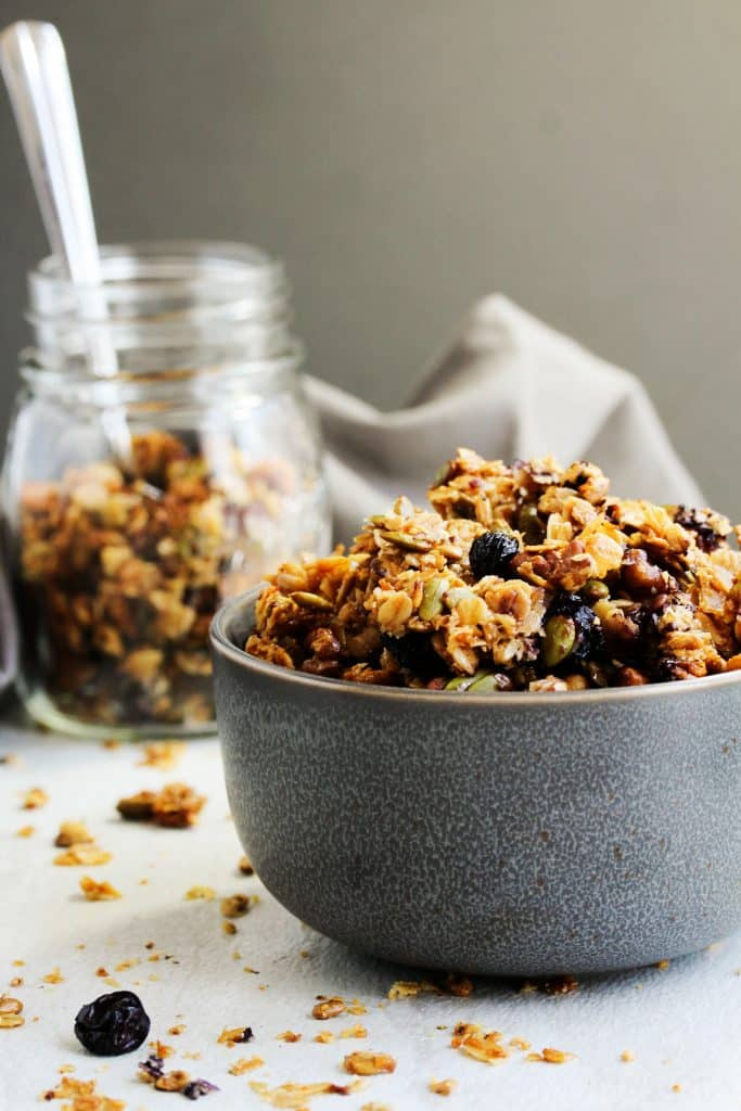 This high protein, crunchy, clustery blueberry granola is you next go-to snack! It's so easy to make, full of wholesome ingredients, and is easy to pack up and grab on the go! Take it to the pool or on a car trip, everyone's going to love this summer snack staple! #HealthyHacks